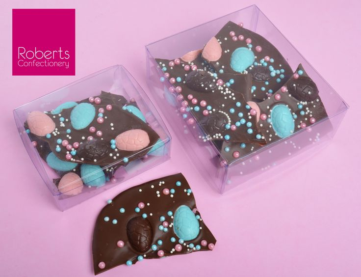 Strawberry Flavoured Chocolate Bark - made using Roberts Confectionery Mini Egg mould. Roberts Confectionery Milk & Dark Chocolate melts coloured with Roberts Confectionery Blue & Red Powder Dyes. Flavoured with Roberts Confectionery Strawberry Oil. Placed in Roberts Confectionery Acetate Box.