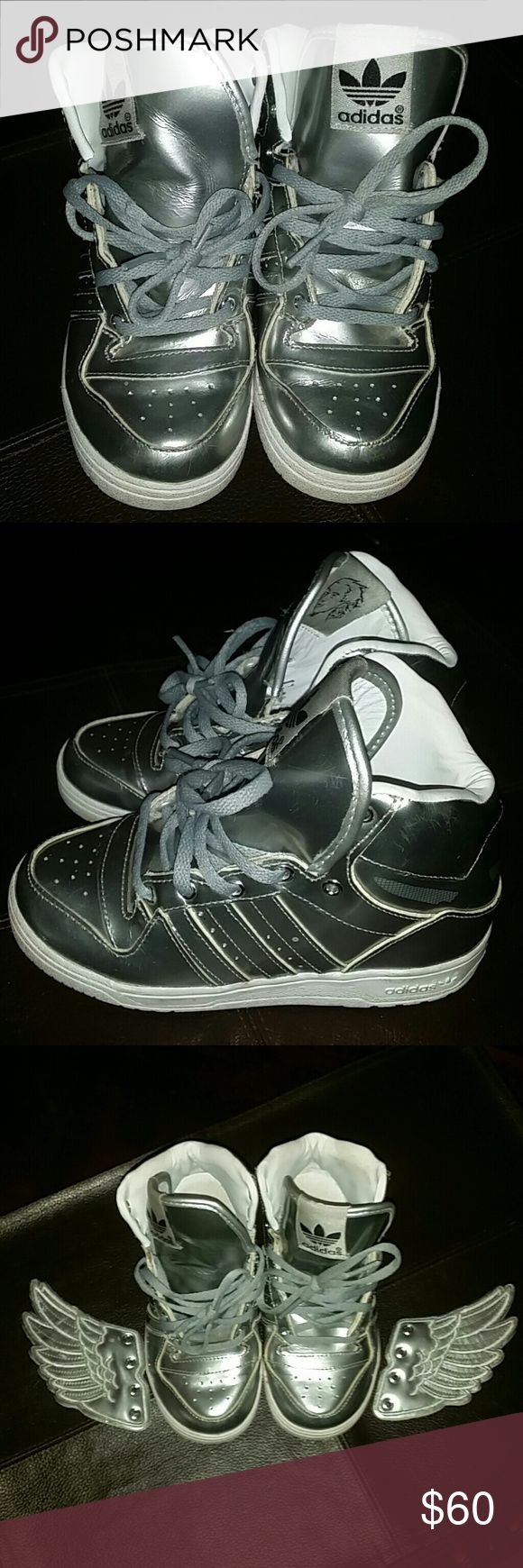 Silver Jeremy Scott silver Adidas Toddler boy/girl Jeremy Scott silver Adidas with removable wings. Shoes have been lightly used still in good condition. Size is 10 Jeremy Scott x Adidas Shoes Sneakers