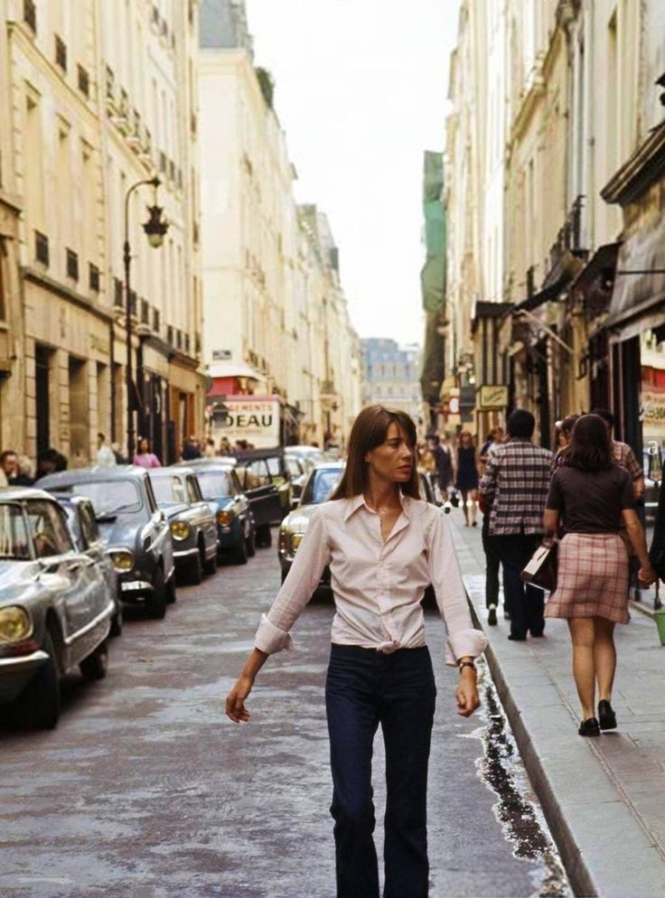 Françoise Hardy walking in a street near the apartment she just rent on the Île Saint-Louis in Paris. circa 1970. Photo by Michael Holtz