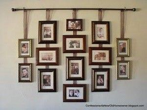 Wonderful idea for hanging a group of pictures without putting a million nail holes in the wall.