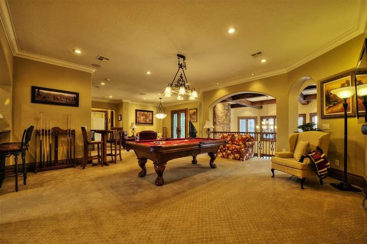 Traditional Game Room with Carpet, Columns, Chandelier, High ceiling, Crown molding