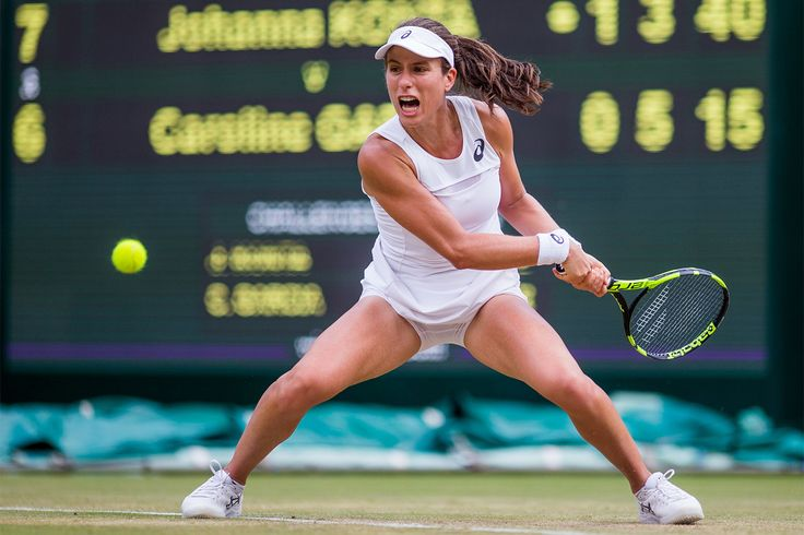 Johanna Konta powers a backhand as Carolina Garcia stages a comeback in the second set on No.1 Court