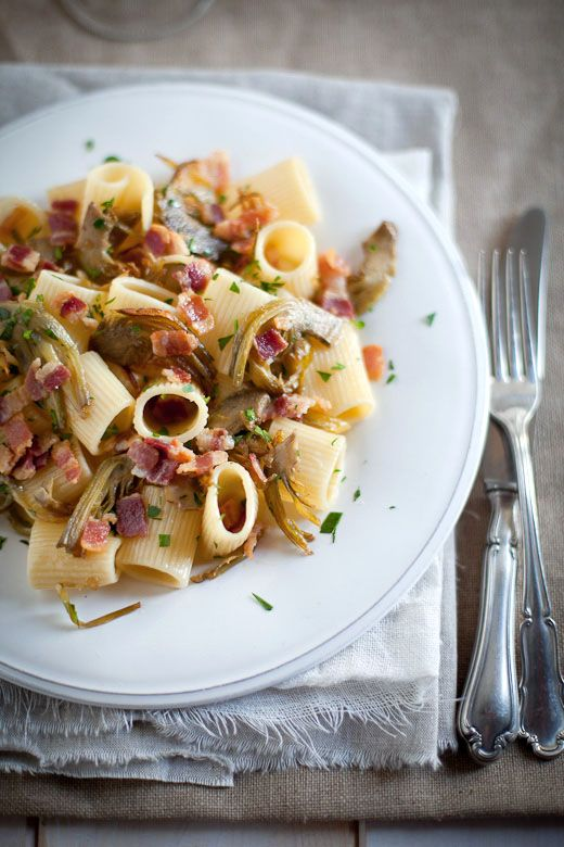Pasta with fresh artichokes, smoked bacon and parsley from one of our favorite Italian food blogs.