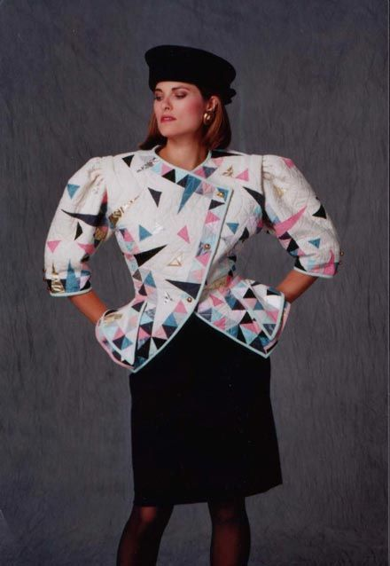 The 80's shoulder pads..  Why pray tell?!?  Was it to distract from broad hips? to divert the eyes from bad acne? Was it to make a 34 inch waist look small?  So many questions..  but no answers-: