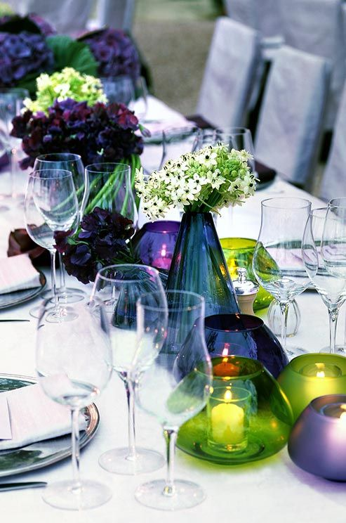 Shades of purple, blue and emerald combine for a simple and chic color scheme atop a crisp white table.