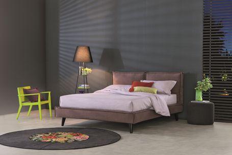 BRAVO METRO upholstered low storage bed.