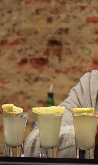 Lemon Drop shot Recipe: - 1 1/2 oz Vodka - 1/4 oz Fresh Lemon juice - 1/4 Sugar Suryp Glass: Shooter Ice: None Garnish: Sugar coated lemon wedge
