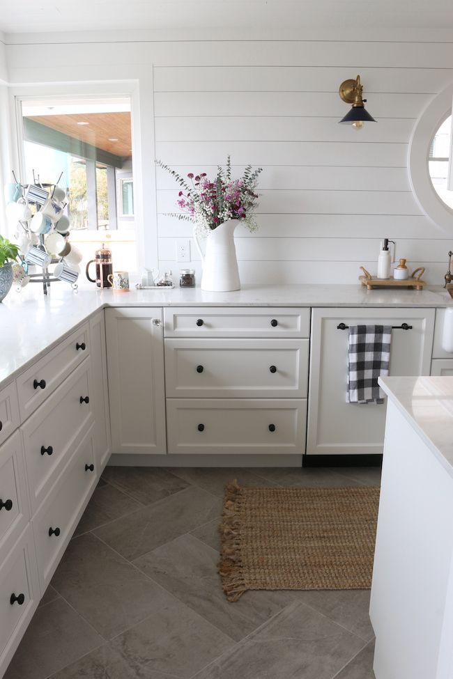 A Really Warm Inviting White Kitchen With Unique Black Cabinet Hardware Wood Plank On