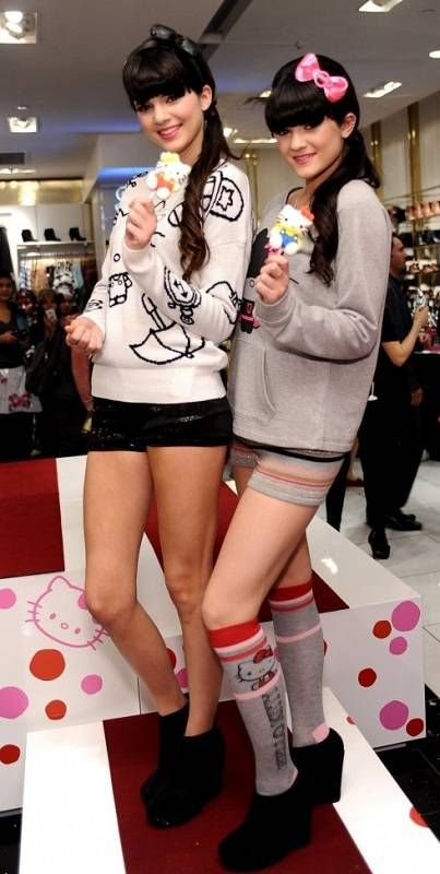 Hot Kylie posing with her elder sister Kendall Jenner for Hello Kitty Forever during a Fashion Week