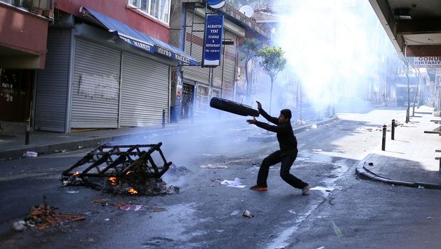 Leftist demonstrators set on fire a barricade as they clash with riot police using tear gas to disperse them during May Day celebrations in Istanbul. |AP