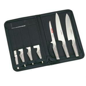 Global 7 piece knife set with razor sharp molybdenum/vanadium 18 stainless steel blades with a Rockwell rating of 56-58. Smooth and seamless construction eliminates dirt traps for superior hygiene. Contains 200mm Cooks knife, 210mm carving knife, 160mm boning knife, 130mm hollow handle cooking knife, 140mm hollow handle vegetable chopper, 150mm hollow handle utility knife & 80mm peeling knife.  http://www.nisbets.co.uk/global-7-piece-knife-set-case/CC390/ProductDetail.raction