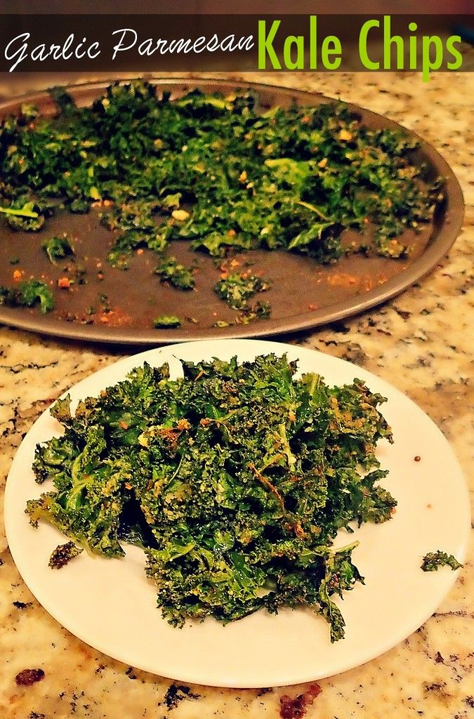 -Preheat the oven to 350 degrees.  -In a large mixing bowl massage kale for about 4 minutes with 2-3 tablespoons of olive oil.  -Add parmesan and garlic! (4 tablespoons parmesan & 1 tsp of garlic powder)  Bake for 15-20 minutes or until the kale is complete crisp. I like to leave the kale in the oven after I turn it off to make it extra crispy. I store the leftover chips in a plastic baggy out on the counter. The kale stays crisp and lasts several days.