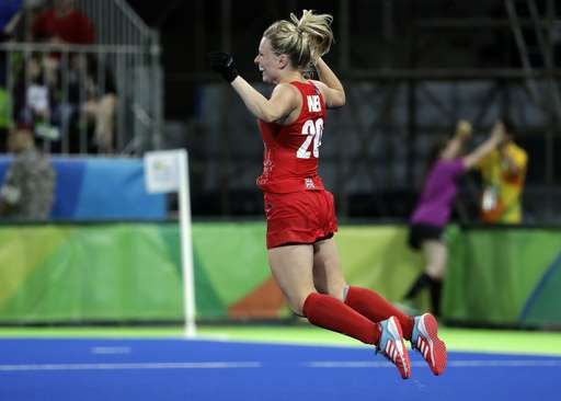 Britain tops Netherlands, wins 1st women's field hockey gold:  August 19, 2016  -     Britain's Hollie Webb, jumps as she celebrates after she scored the last winning penalty shootout goal against Netherlands, during a women's field hockey gold medal match at 2016 Summer Olympics in Rio de Janeiro, Brazil, Friday, Aug. 19, 2016. (AP Photo/Hussein Malla)