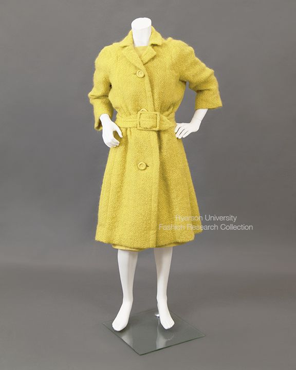 Yellow boucle wool belted coat, slightly gathered at waist. Atelier label reads: 143C Dior Sanfran. Label reads: Christian Dior for Holt Renfrew. C. 1960s. FRC 1997.04.044