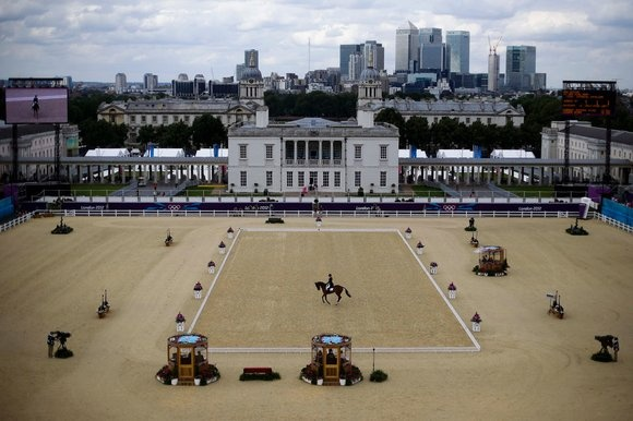 Mary King of Great Britain competes with her horse Imperial Cavalier in the equestrian eventing dressage phase at Greenwich Park, the site for the equestrian and modern pentathlon events at the 2012 Summer Olympics, Saturday, July 28, 2012, in London. (AP Photo/Markus Schreiber)