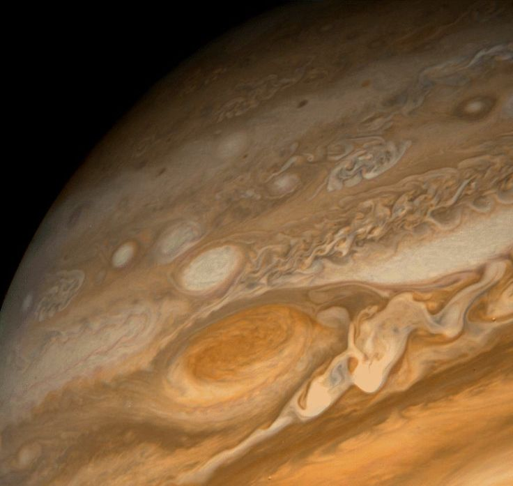 The Great Red Spot of Jupiter, as seen from the Voyager 1 spacecraft, a gigantic hurricane-like storm system that has been raging for over 300-years, and perhaps much longer. Three Earths could fit inside it.