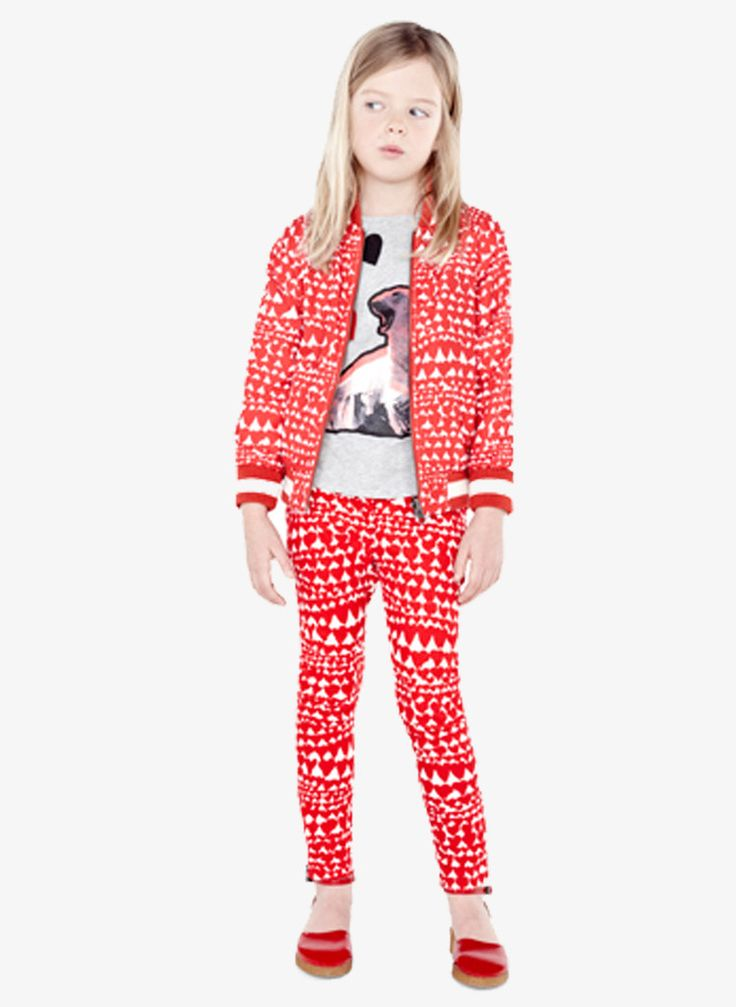 Cotton stretch jeans in all over red heart print. Skinny fit with ankle zips and five pocket detail, concealed zip and hook fastening and Stella McCartney logo on back.