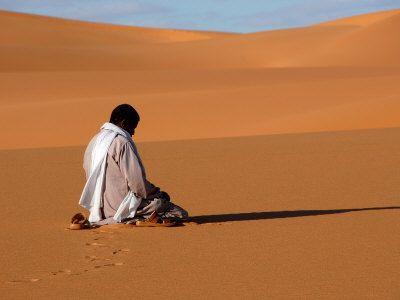 Godong  Muslim Man Praying in the Desert, Sebha, Ubari, Libya, North Africa, Africa - Photographic Print