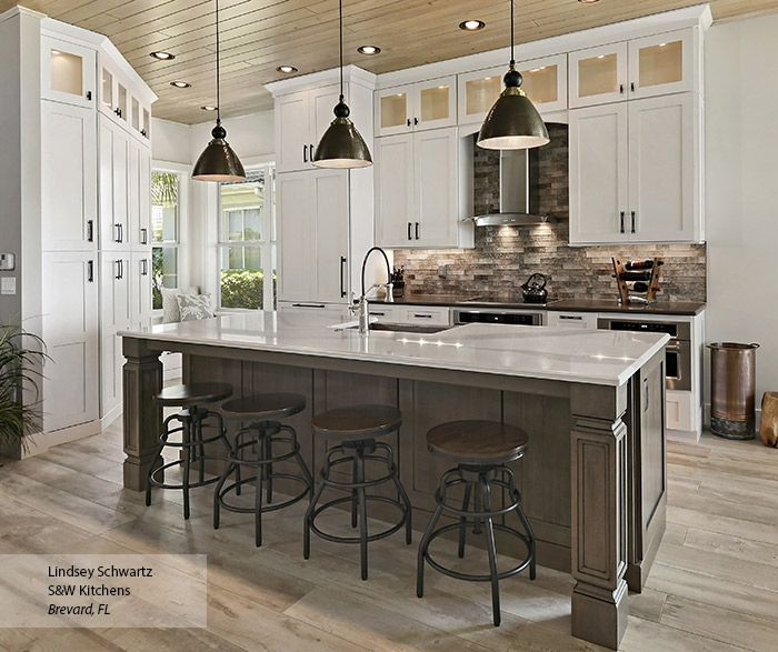 island for kitchen glass inserts in stacked cabinetry provide a beautiful 13094