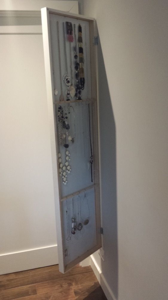 IKEA STAVE mirror hides jewellery organiser...or to buy a regular mirrpr and DIY...love it