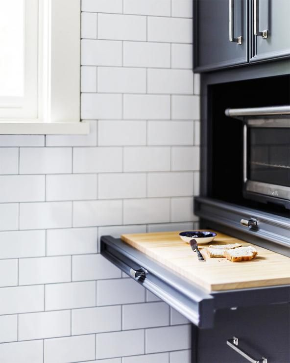 Pull out cutting board under toaster oven