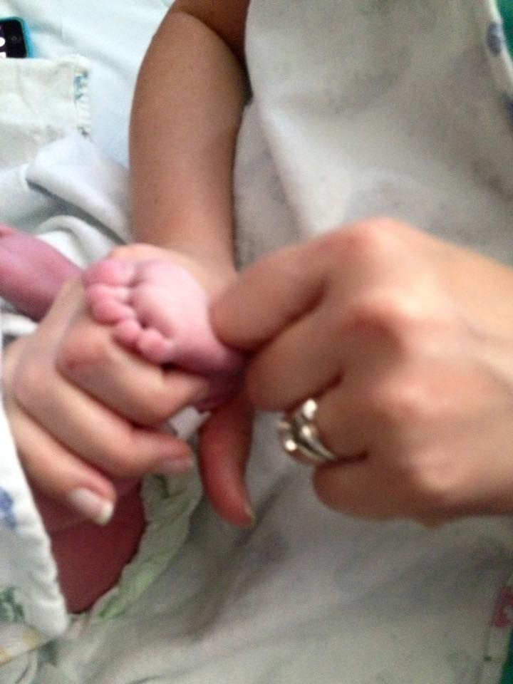This little one swallowed some amniotic fluid, so she got a foot zone at 4-hours old.