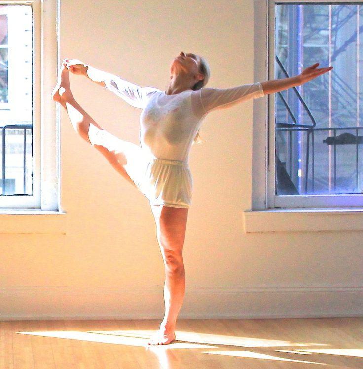 Iyengar Yoga teacher Carrie Owerko in Utthita Hasta Padangustasana lateral