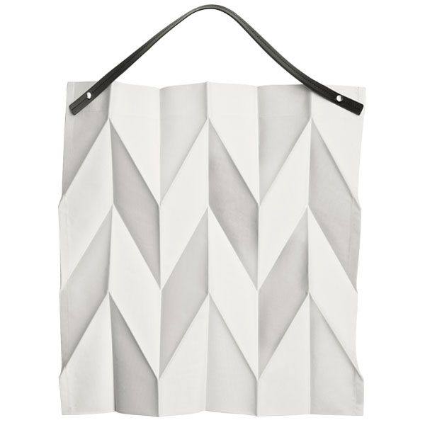 Iittala X Issey Miyake is a collaboration between the Finnish design house Iittala and the Japanese designer Issey Miyake. This tote bag is inspired by origami and changes shape according to the size and weight of the objects it carries. The bag folds flat making it ideal as a secondary shopping bag.