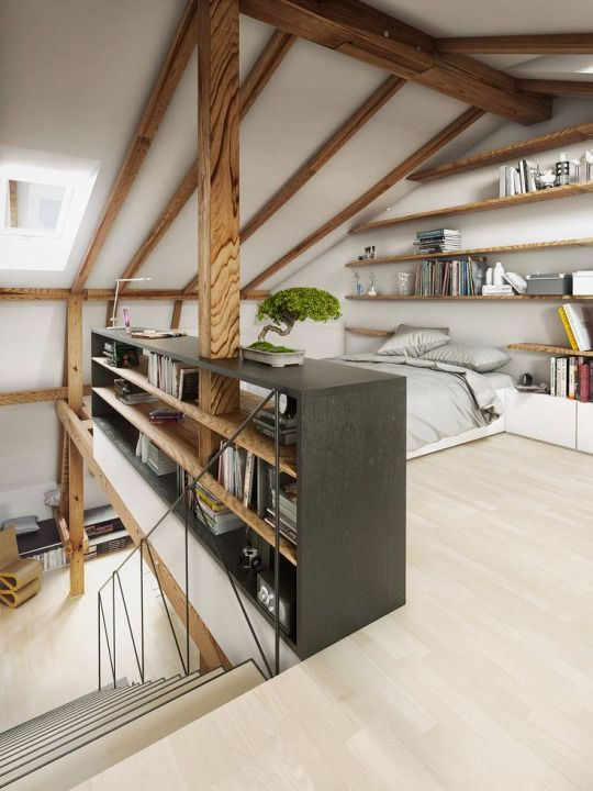 Converted attic bedroom with bookshelves as a small partition wall