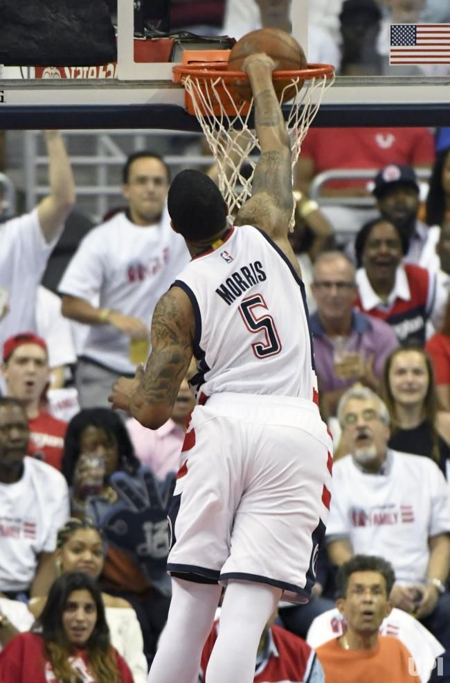 Washington Wizards forward Markieff Morris (5) scores on a dunk against the Atlanta Hawks in the first half at the Verizon Center in…