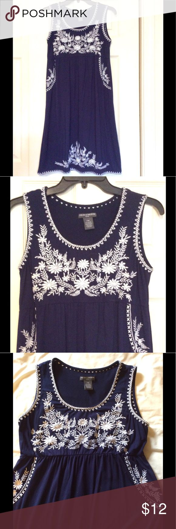 """Sleeveless Navy Cotton Knit Dress White Embroidery Chelsea & Theodore, Size Petite Medium, Sleeveless Navy Cotton Knit Dress White Mexican-style Embroidery, elasticized empire Waist with soft gather front and back, Embroidered hem, loose fitting. Great Spring/Summer dress for barbecues & the beach! Measures 13"""" across shoulders, 17"""" armpit to armpit, 35"""" long. BUNDLE and SAVE Chelsea & Theodore Dresses"""