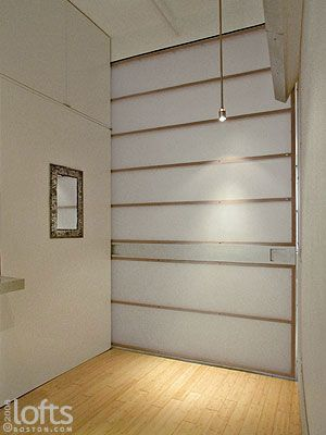 A Custom Built, Translucent Slider/wall Panel Can Be Closed, Providing  Privacy
