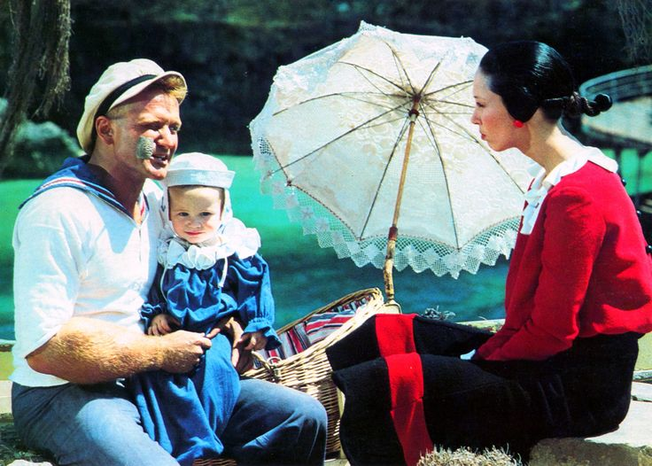 """""""Popeye"""" movie still, 1980. L to R: Robin Williams as Popeye, Wesley Ivan Hurt as Swee'Pea, Shelley Duvall as Olive Oyl."""