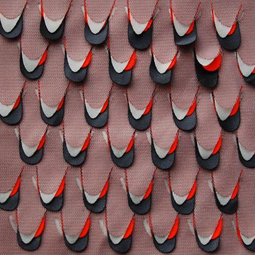 Textile by Dutch designer Studio Elke Van Den Berg. Layers of laser-cut fabric that fit together. via the designer's site