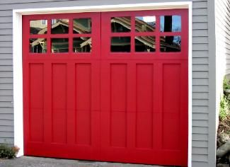 painted red clopay reserve collection wood carriage house garage door as seen in this old house