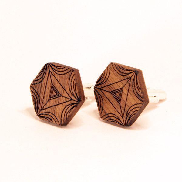 Trigon cufflinks are etched from walnut or oak.
