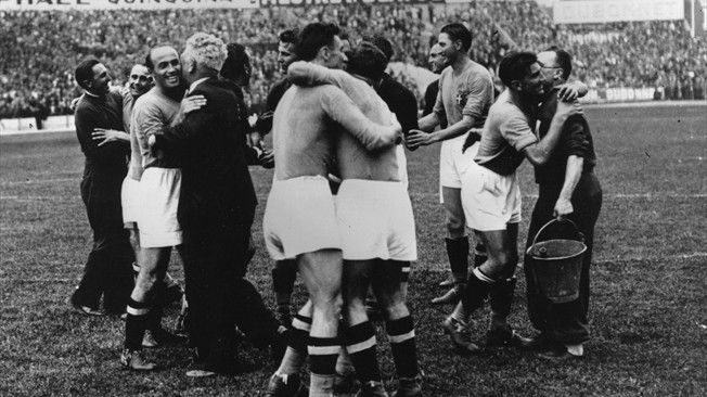 The Italians celebrate after the final