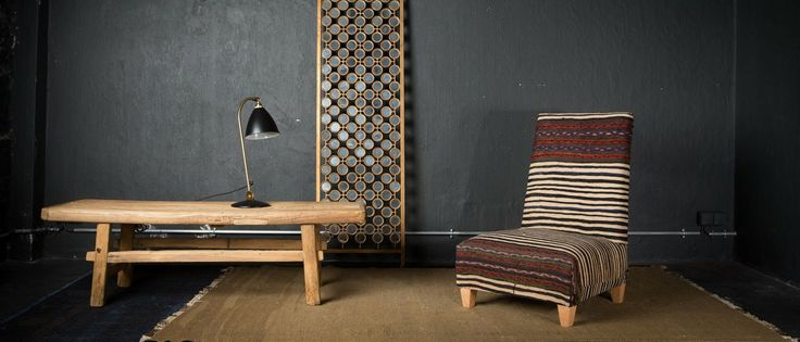 LA MAISON GÉNÉRALE la boutique mobilier design de Saint Malo.  Chauffeuse recouvert d'un tapis ancien Afghan multicolore