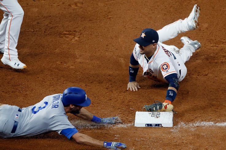 Game 3:  Astros start fast, top Dodgers 5-3 for 2-1 World Series lead.  HOUSTON, TX - OCTOBER 27:  Yuli Gurriel #10 of the Houston Astros dives to tag first base for the out as Chris Taylor #3 of the Los Angeles Dodgers slides during the seventh inning in game three of the 2017 World Series at Minute Maid Park on October 27, 2017 in Houston, Texas.  (Photo by Bob Levey/Getty Images)