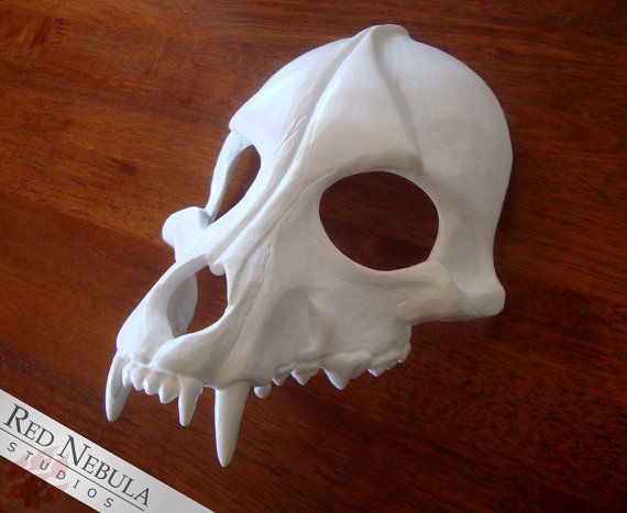 This lovingly detailed canine skull mask is cast in high quality resin and works equally well as a face mask, headdress, or even a pauldron (shoulder armor)! It was sculpted to resemble the upper jaw of a realistic wolf, dog, or coyote skull right down to the detail of every individual tooth.  The mask comes with the eye and nose holes cut out. You can choose to leave them open or cover them with black mesh fabric for an eerily empty look. (I have mesh fabric available in the shop that works…