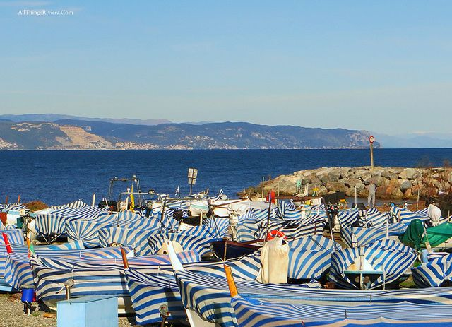 Boats by a beach in Albenga  #ItalianRiviera  http://allthingsriviera.com/