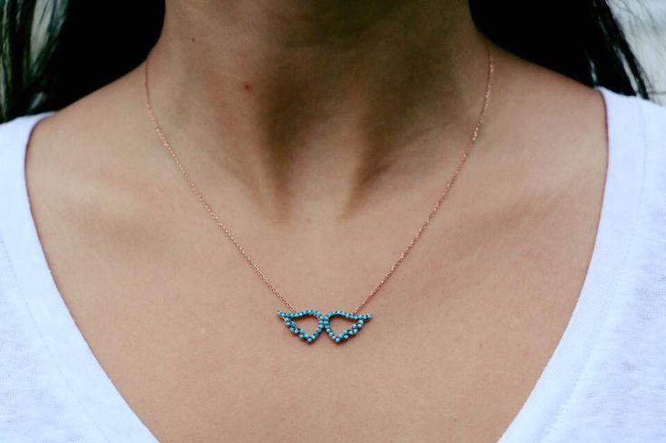 Engelflügelkette mit blauen Zirkonia Steinen