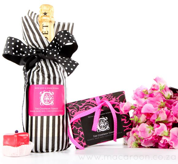 Spoil your hostess with beautifully wrapped gifts - a bottle of Champagne, a box of chocolates and a fresh bunch of flowers http://www.macaroon.co/macaroon/content/en/macaroon/gift-labels?oid=1632&sn=Detail&pid=135348&Macaroon-Monogram---Landscape