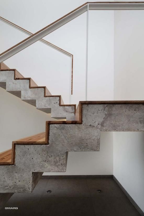 8. The combination of concrete and wood create modern, strong staircase that still has a warmth and lightness to it. The light colour of the concrete lightens the whole structure and area and creates an illusion that the wood scales up to the next level without assistance from the concrete.