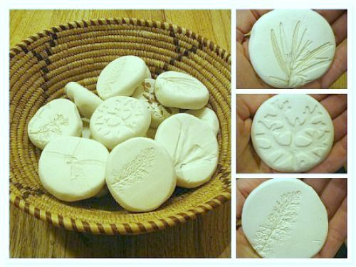 Using Sculpty Clay and Nature Items (leaves, twigs, flowers, pine cones, etc...) Round out Clay, flatten like a cookie and press the shapes gently. Bake them at a low temperature (250 degrees) for 45 minutes