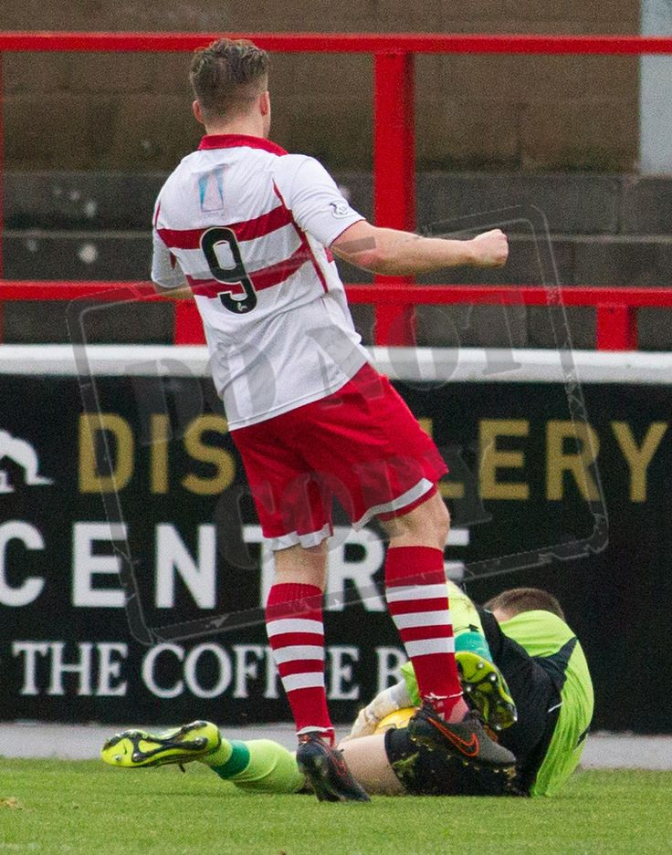Queen's Park's keeper Wulliw Muir dives at the feet of Stirling Albion's Steven Doris during the SPFL League Two game between Stirling Albion and Queen's Park.