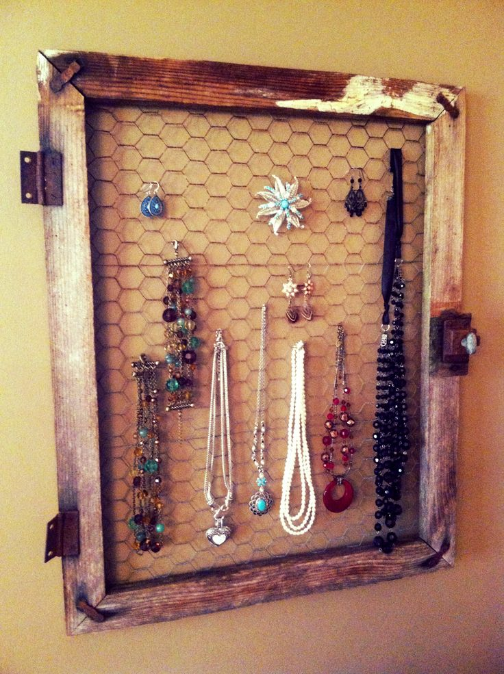 Used old chicken coupe door to make jewelry holder in my country themed bathroom.