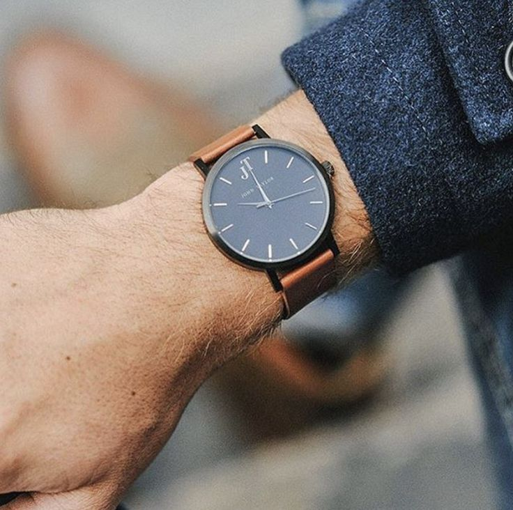 Navy coats and tan straps with John Taylor watches