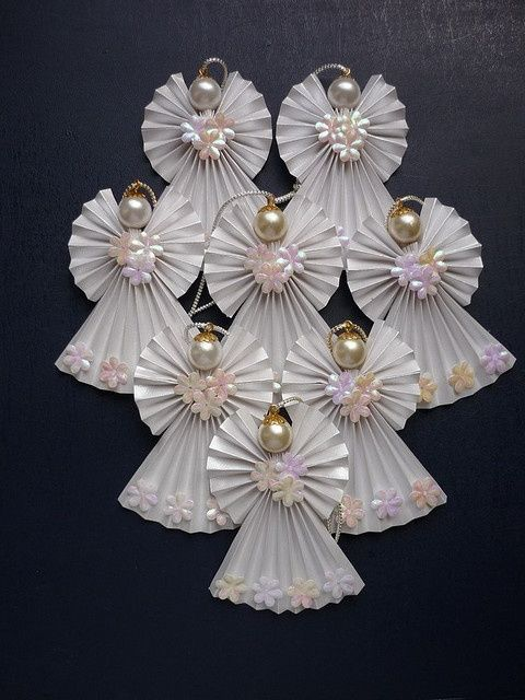 Origami angel ornaments... not a tutorial... but definitely a DIY.  Use for inspiration! ... http://pinterest.com/pin/203717583115834046/