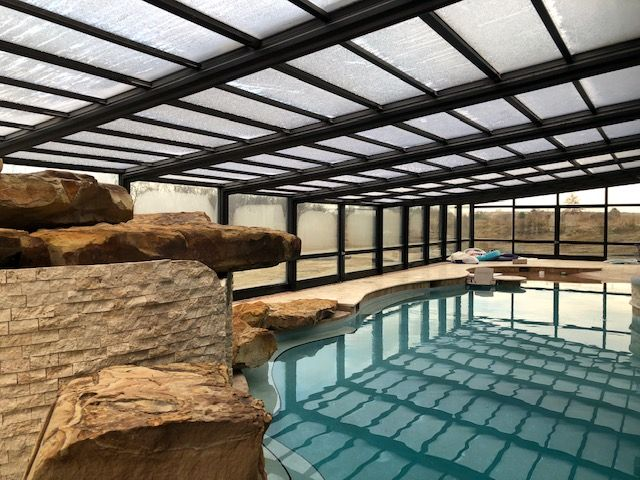Ohio Pool Enclosure Manufactured By Roll A Cover Indoor Outdoor Pool Residential Pool Swimming Pool Enclosures